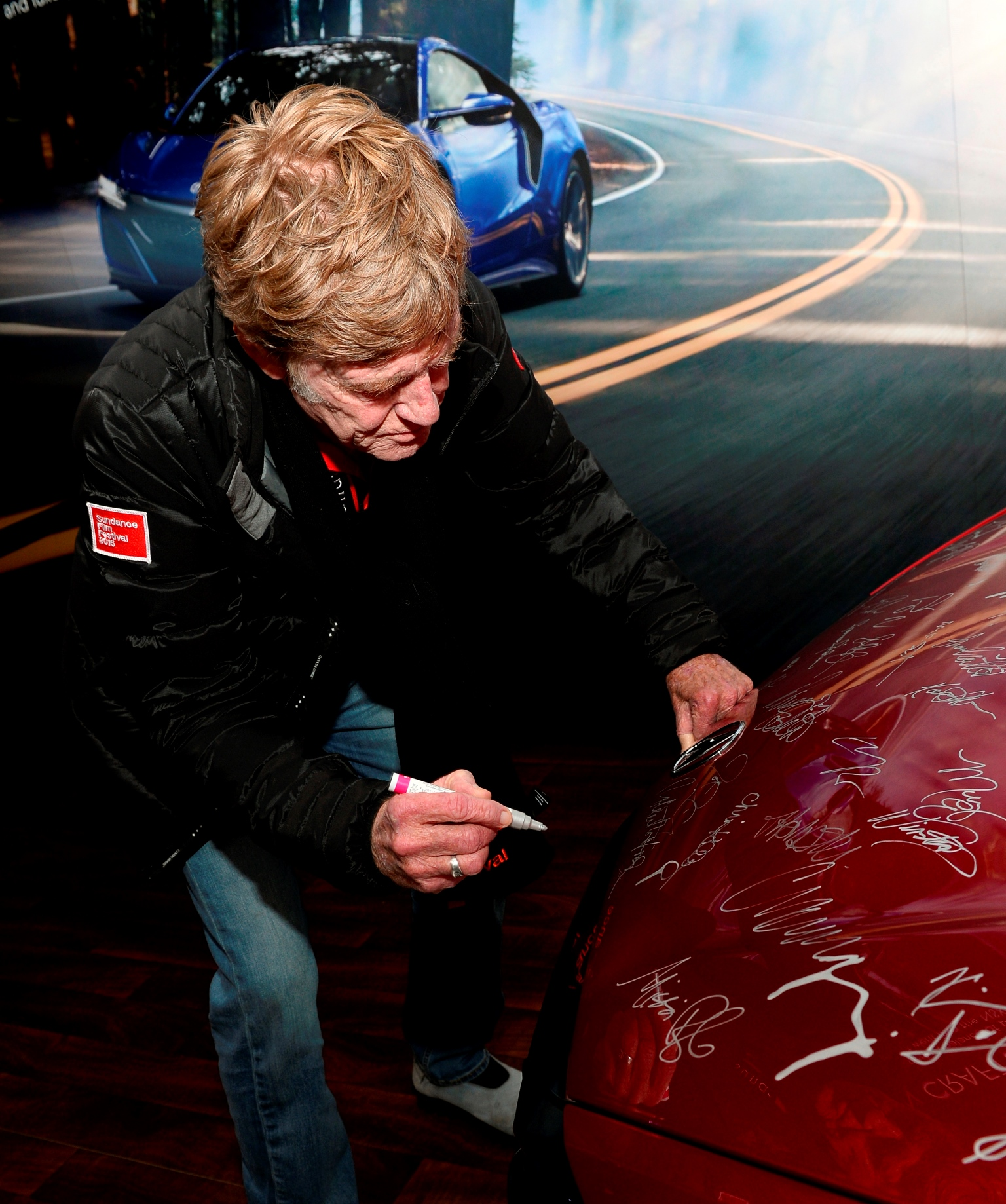 Robert Redford Signing The 2017 Acura NSX Hood At The