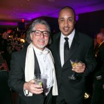 Former New York Knicks player John Starks (right) cheers to the new year with a guest at the New Year's Eve festivities at The Knickerbocker Hotel, located at the edge of Times Square. Rumored to be the birthplace of the Martini, this was The Knickerbocker's first New Year's celebration in 95 years after Prohibition caused the close of the hotel in 1921. The property reopened in February 2015 after completing a spectacular $250 million dollar redevelopment.