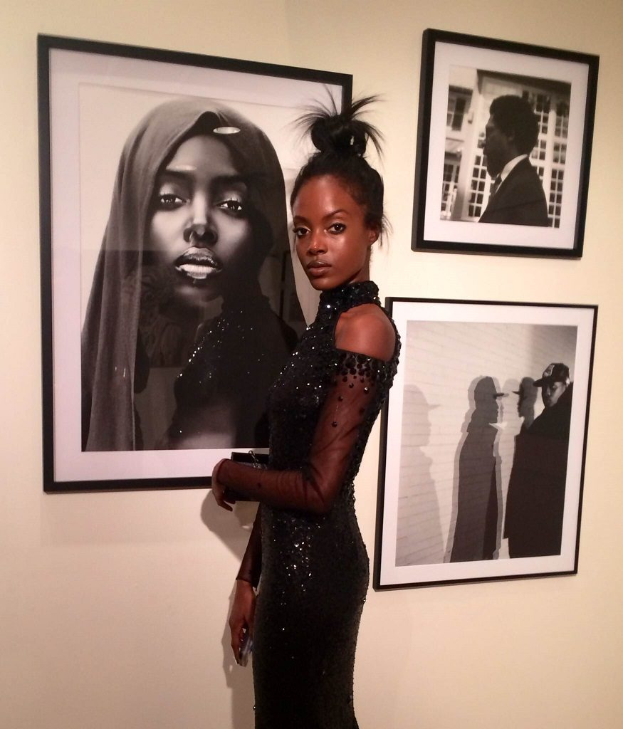 Model Madisin Rian next to a limited edition print of the viral image 'Black Madonna' a photo of herself by Andreea Radutoiu that even caused an international bidding war (photo by Joakim von Ditmar)