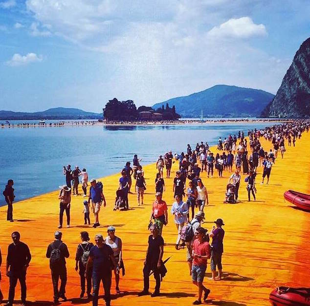 The scene on opening day before noon on the 'Floating Piers' a legion of boat hands, lifeguards, monitors and information officers standing guard to avert unintentional dips in the lake